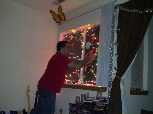 After the decorations were made, Jessica and I put them up along with the lights.