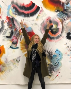 In front of my husband's art