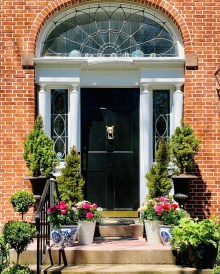 Front entrance of Fox Hall in summer