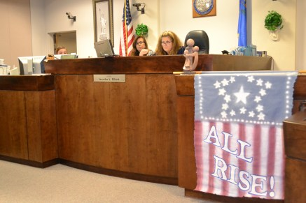 Judge Elliot has an all rise banner in her courtroom to remind us that when rises, we all rise.