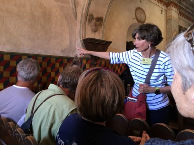 Lin pointing out details in the baptistry