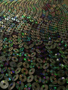 CDs reflect the light in colorful ways