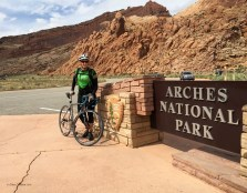 The trail passes the entry to Arches National Park