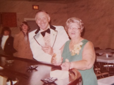 Dad and Mom with celebratory drinks at Swister Sue's wedding reception, September, 1975.