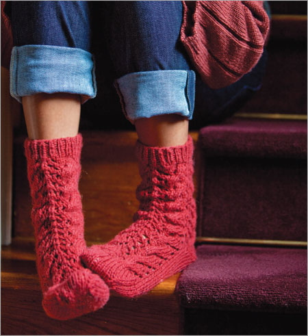 Kumara Bed Socks showing detail of cable and lace pattern.