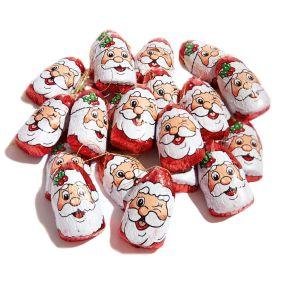 Ob mit zwinkerndem Auge, mit einer Brille oder einfach fröhlich ausschauend, 25 kultige Schokoladen-Weihnachtsköpfe mit Baumhänger. Insgesamt ca. 300g Schokolade. Gewicht: ca. 0,4 kg. Zutaten: Zucker, pflanzliches Fett (Palmkern, Palmöl), 9% Praliné (HASELNUSSMARK, Zucker), VOLLMILCHPULVER, Kakaobutter, Kakaomasse, LAKTOSE, SÜSSMOLKENPULVER, pflanzliches Öl (Sonnenblumen), Kakaopulver (stark entölt), Emulgator: Sonnenblumenlecithine, E476; Aromastoffe. Allergiehinweis: Kann Spuren enthalten von: GLUTEN und andere SCHALENFRÜCHTE!<br>