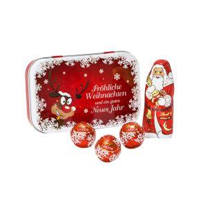 Kleine Metalldose mit weihnachtlichem Motiv. Gefüllt mit einer exquisiten Lindt-Füllung. Ein Weihnachtsmann 10g, drei Mini Lindor-Kugeln, auf weißer Pergaminwolle gebettet. Zutaten: Zucker, pflanzliches Fett (Kokosnuss, Palmkern), Kakaobutter, VOLLMILCHPULVER, Kakaomasse, LAKTOSE, MAGERMILCHPULVER, BUTTERREINFETT, Emulgator: SOJALECITHINE; MALZEXTRAKT, Aroma Vanillin; Aromen. Allergiehinweis: Kann Spuren enthalten von: anderen SCHALENFRÜCHTE!<br>