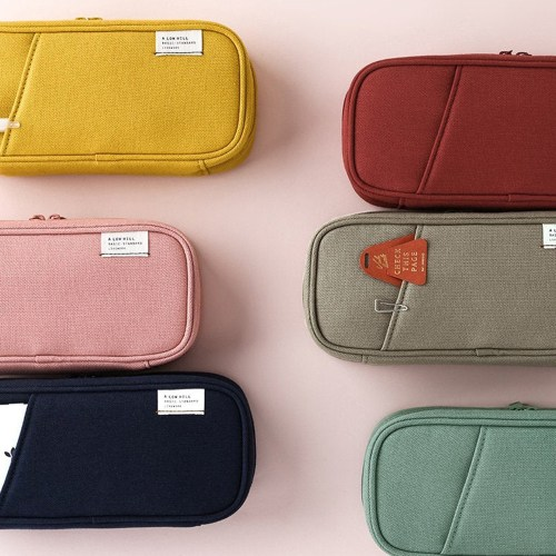 Walmart Back to School Essentials by popular interior design blog, E. Interiors: image of various pencil cases on a pink backdrop.