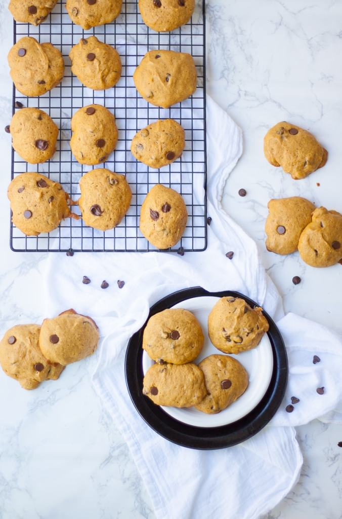 HOLIDAY BAKING ESSENTIALS by popular interior designers blog E. Interiors: image of pumpkin chocolate chip cookies on a cooling rack.