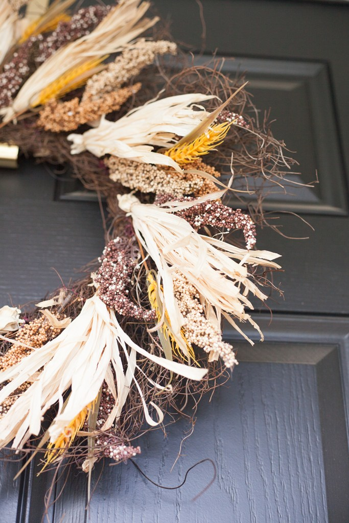 FALL PORCH DECOR WITH WALMART by popular interior designers blog, E. Interiors: image a front porch decorated with a Fall wreath from Walmart.