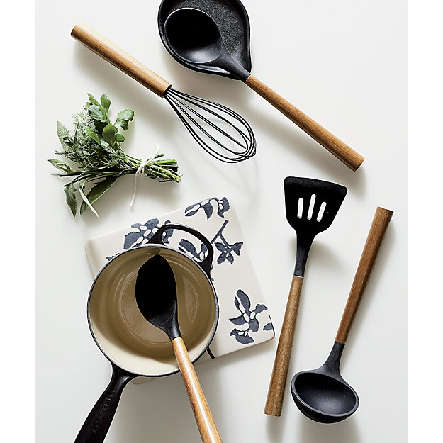 Kitchen Tools by popular US interior design blog, E. Interiors Design: image of a whisk, ladle, spatula, and pot.