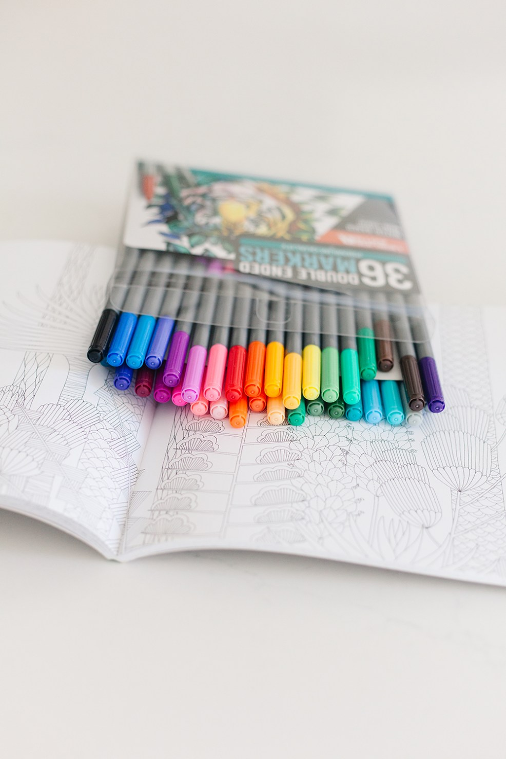Wow and Now by popular US life an style blog, E. Interiors Design: image of a Wow and Now and now coloring book and marker set.