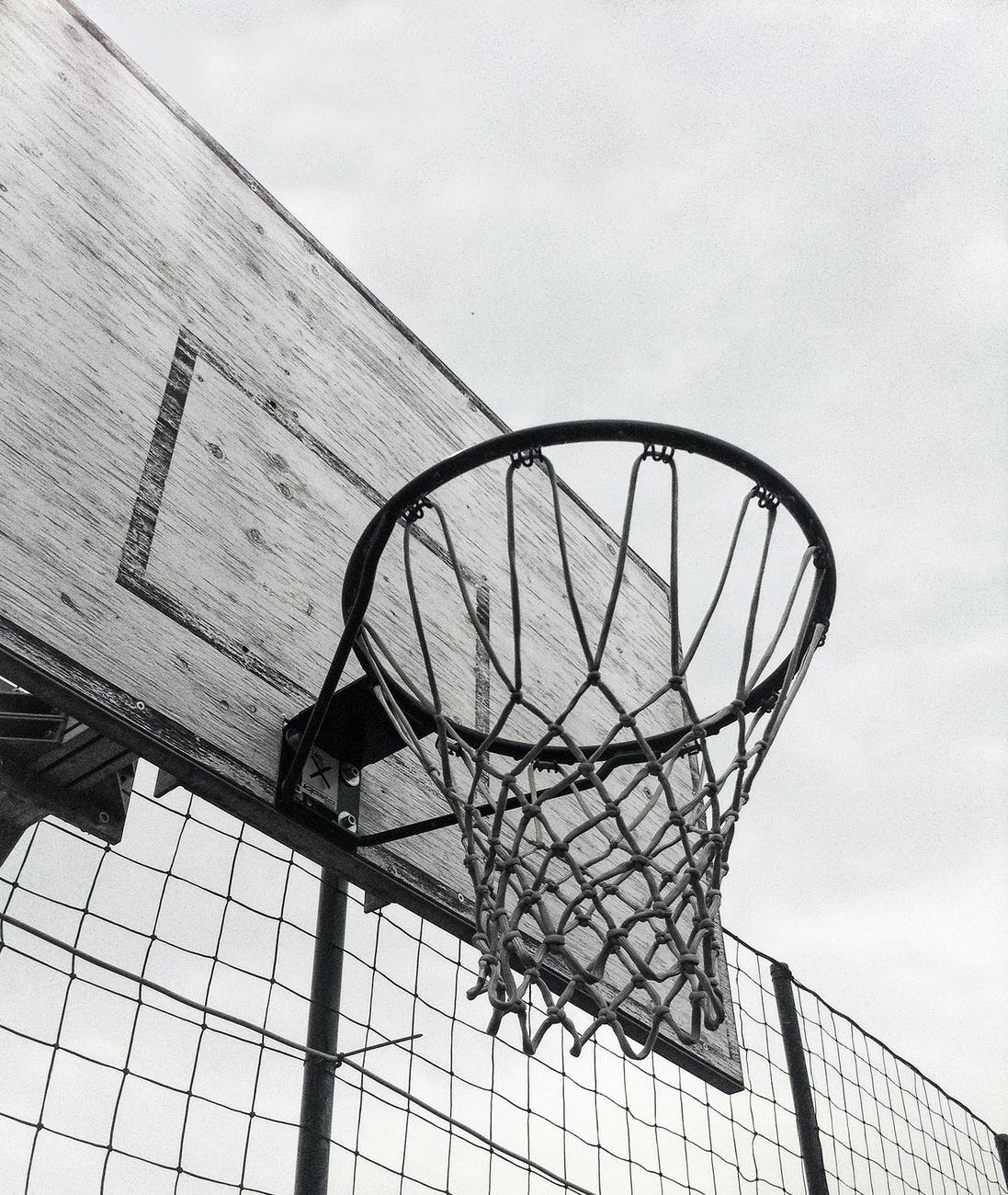 grayscale photography of basketball hoop
