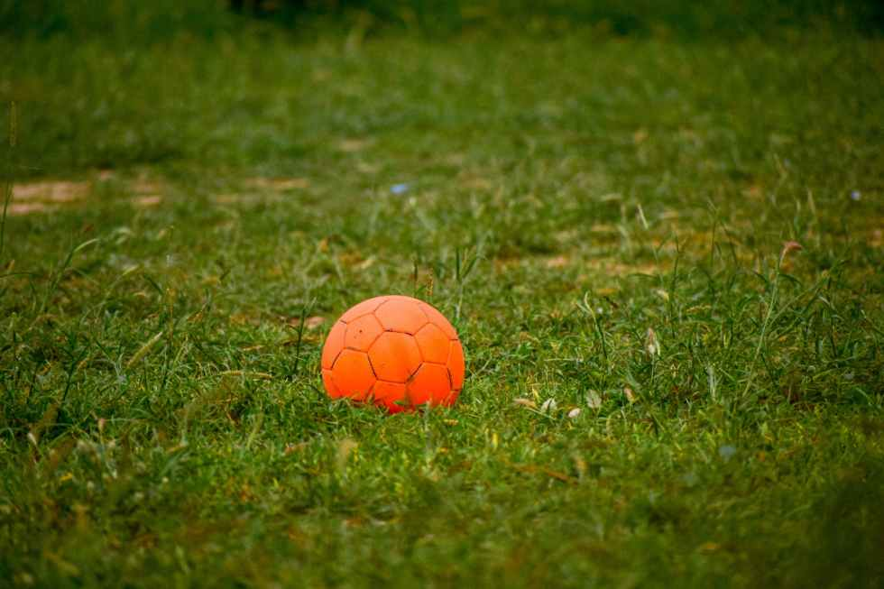 tilt shift lens photography of orange ball