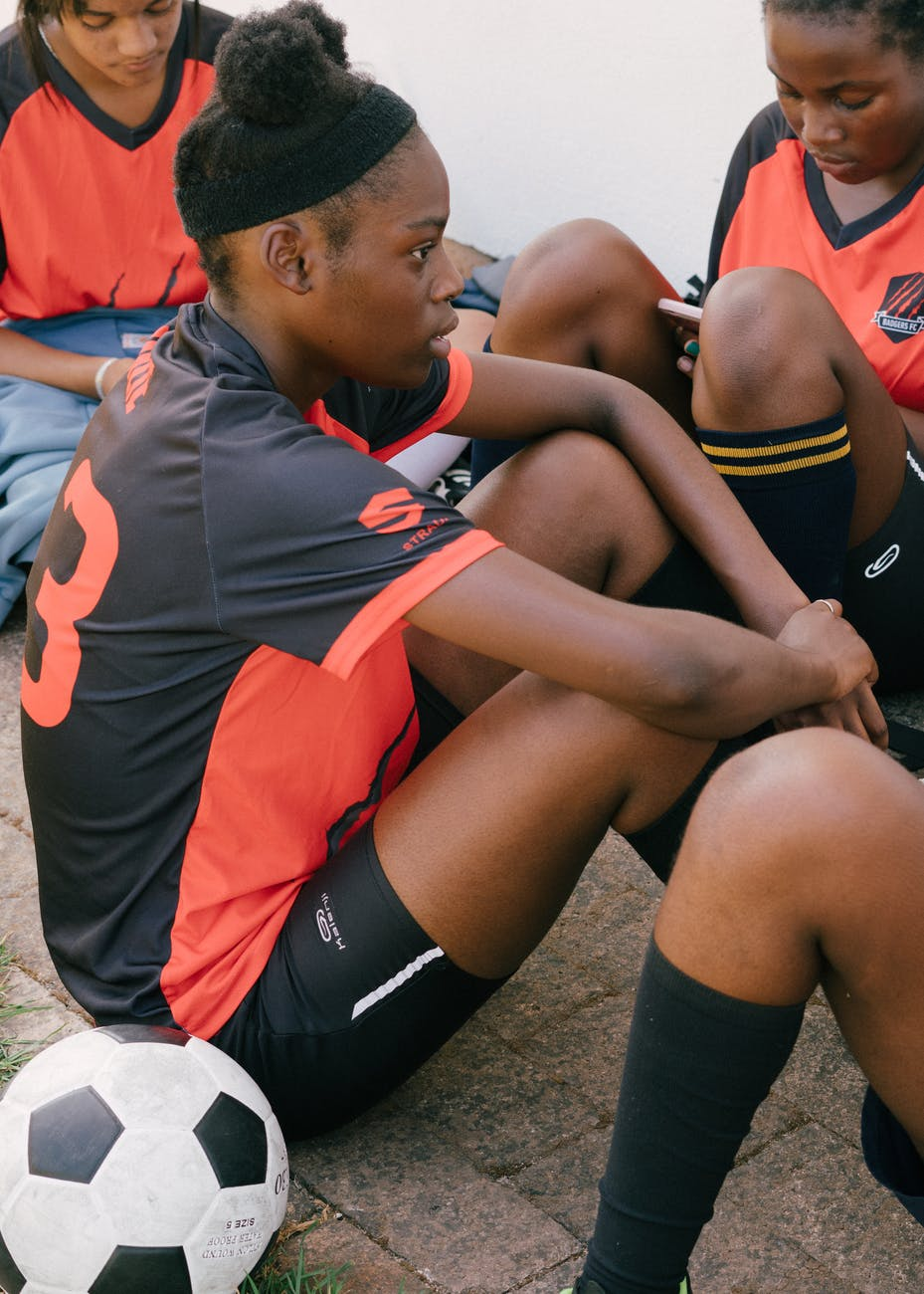 photo of female soccer team during time out