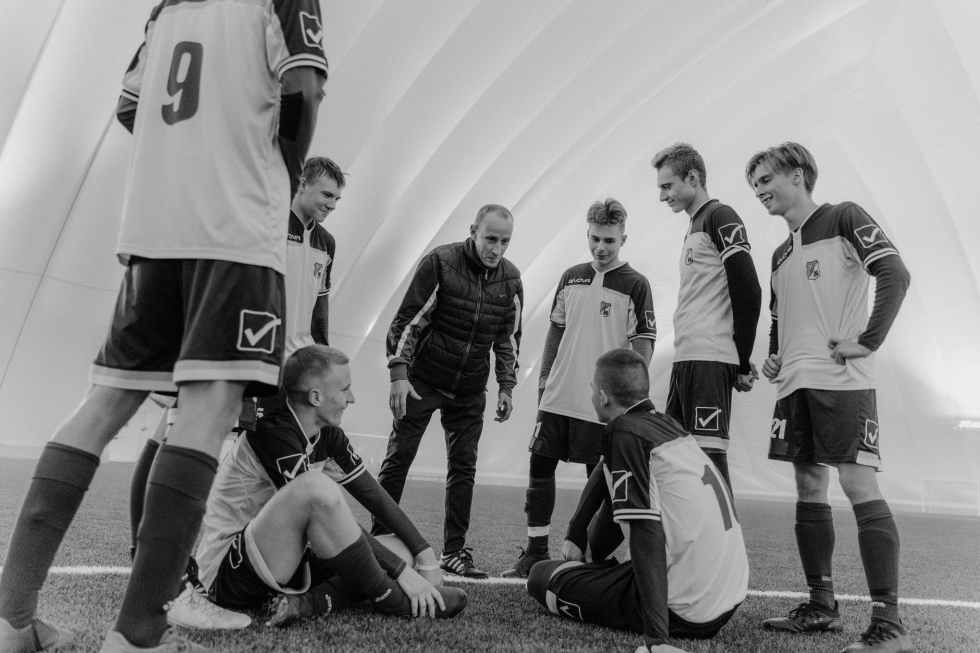 grayscale photo of men in soccer jersey