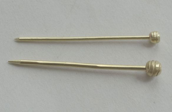 two pins