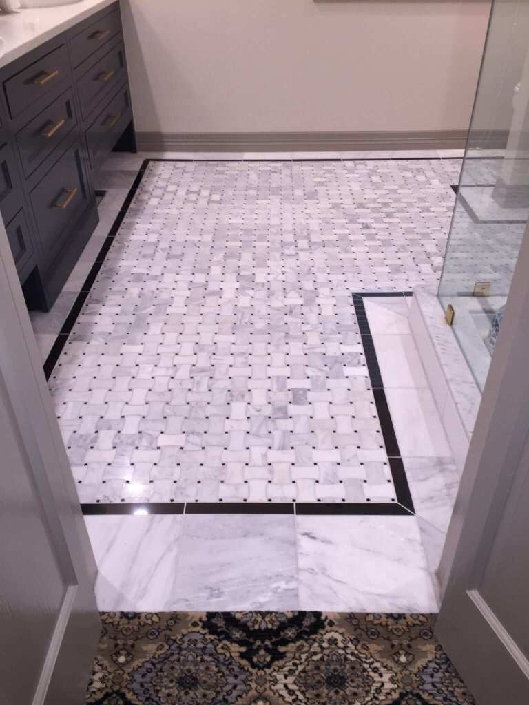 Bathroom remodeled with custom tile floor, paint, new vanity, new counters, shower glass, and shower tile.