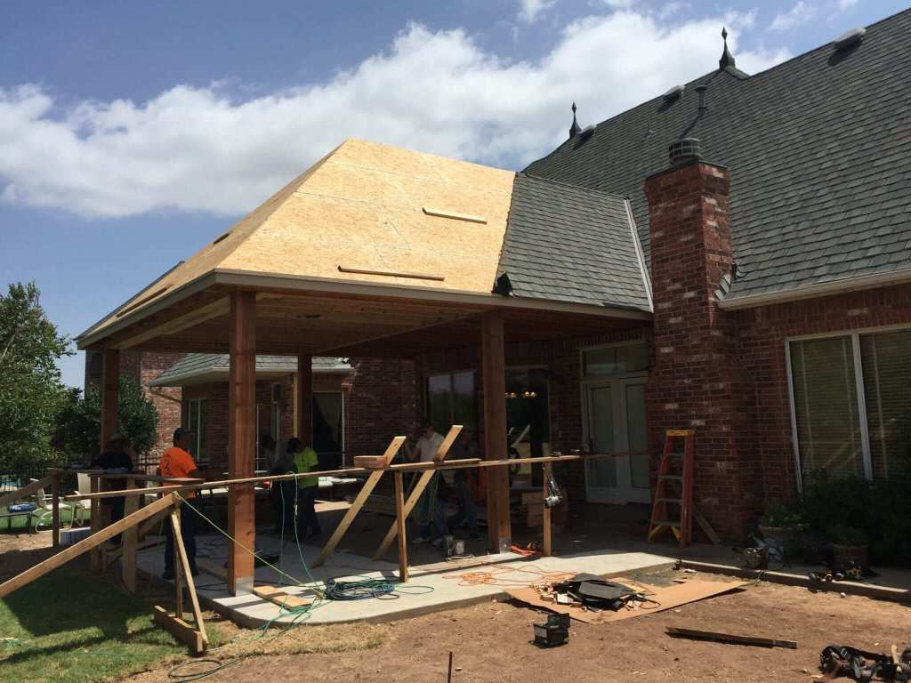 Patio addition constructed with new roof, framing, concrete, painting, cedar posts, speakers, lighting, and power screens.