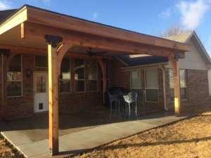 Eisel Roofing & Construction: Cedar columns and beams – bead board ceiling – LED lights – fan – asphalt roof