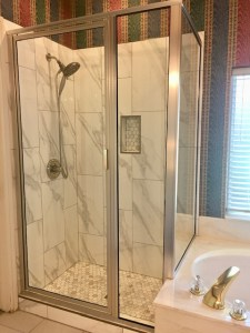 This bathroom was remodeled with new wall and floor tile and new framed shower glass.