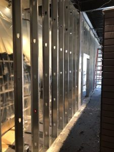 Photo of new metal frame wall within a clothing store.