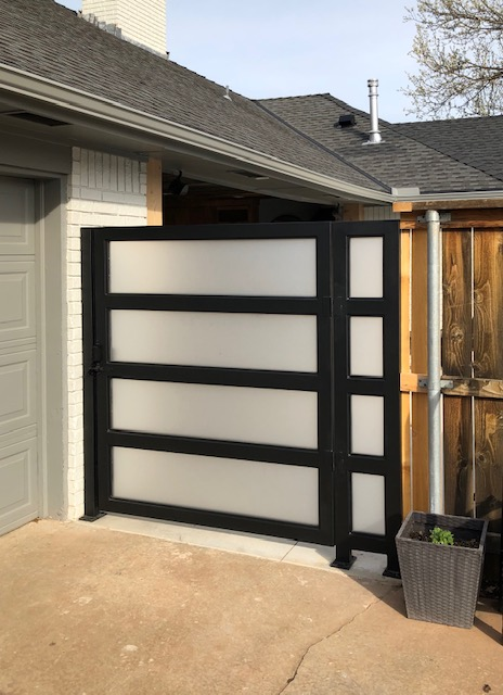 Custom metal gate with fogged inset pieces for privacy.