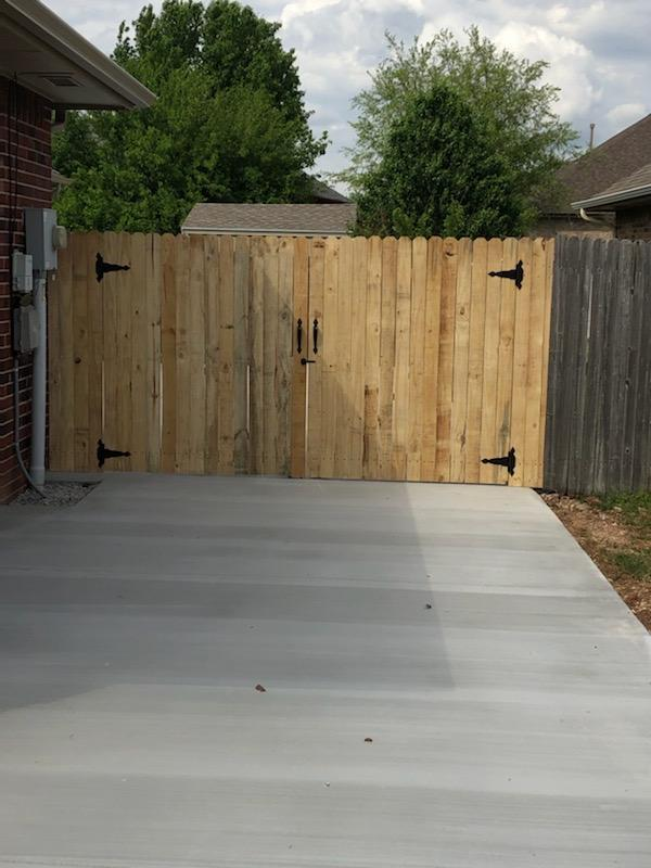 New cedar double gate on new driveway addition.