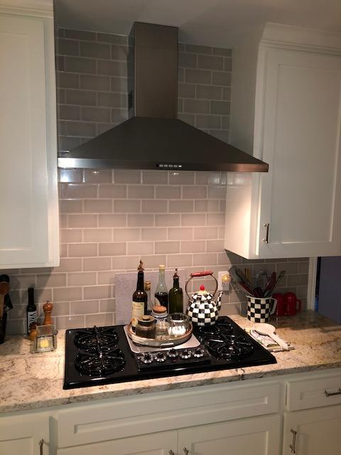 New counters, cabinet paint, backsplash tile, and vent hood.