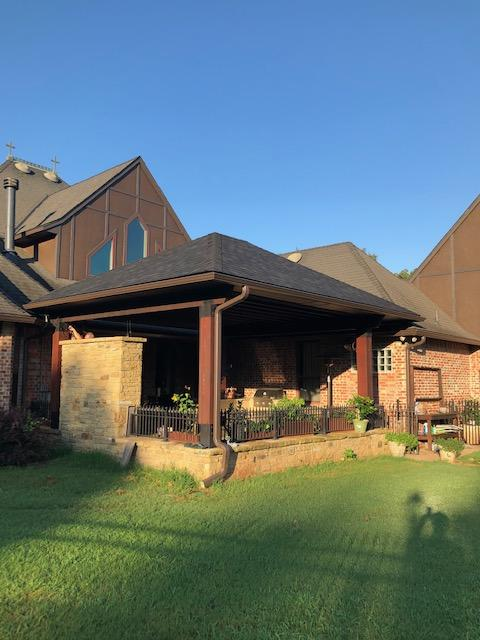 New outdoor patio cover with bead board ceiling and exposed cedar beams.