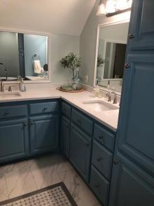 New custom tile floors, new quartz countertops, new walls and cabinet paint.