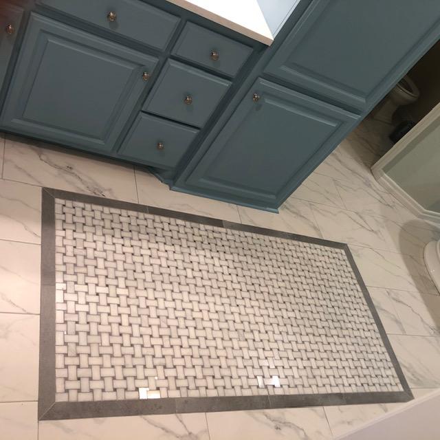 New custom tile flooring in master bathroom.