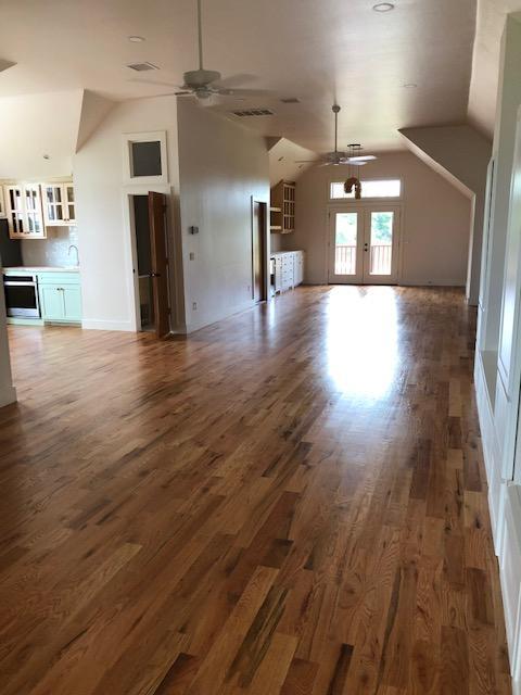 "New flooring in ground up ""barndominium."""