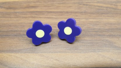 Purple daisy studs with yellow centres