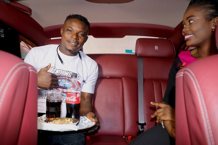 Excitement as Kelly Junior, first winner of Konga Travel Rolls Royce promo, arrives airport in style