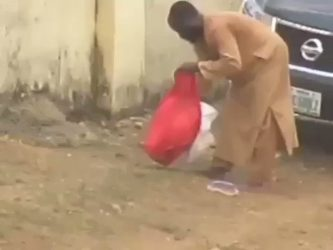 VIRAL VIDEO: Man Who Bury Kyari Dumps Protective Clothing In Public