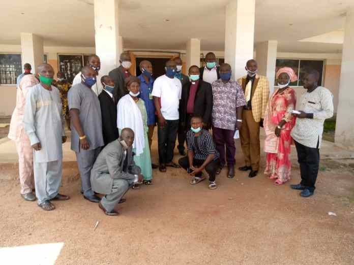 Jema' a Local Government chairman, middle while members of Baptist conference southern Kaduna with their president standing closed to the chairman mr.Danjuma Peter Averik