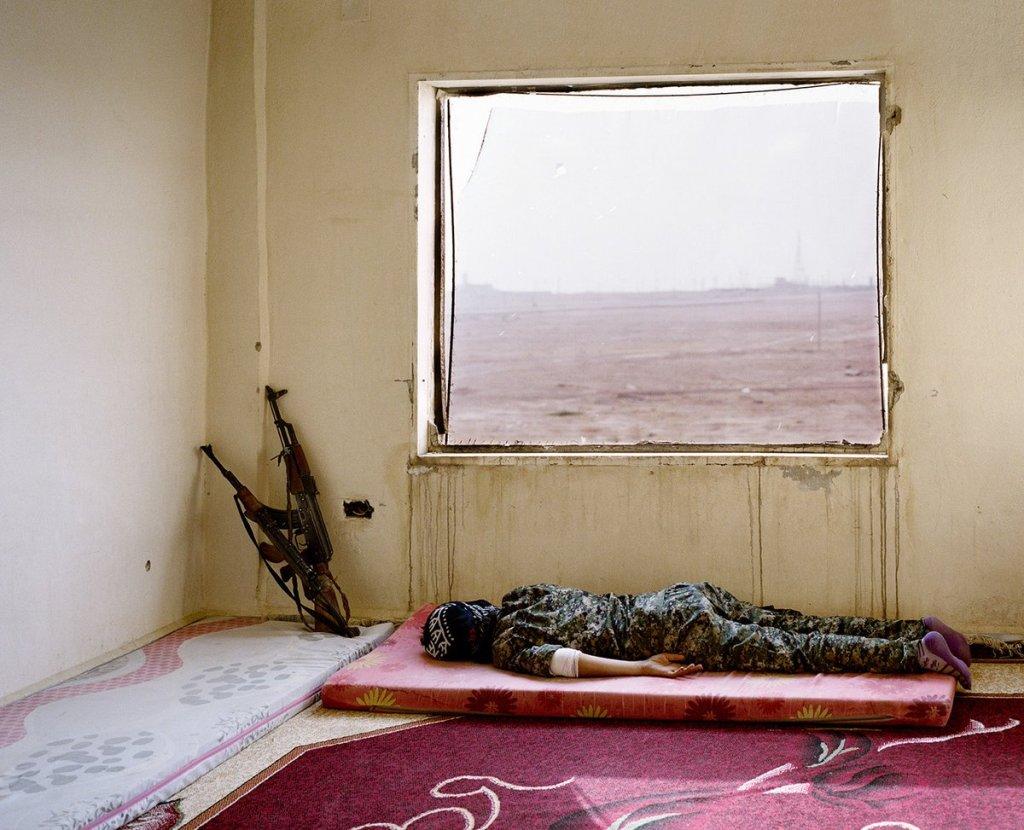 Kurdish fighter resting between battles. https://twitter.com/GforGilgo/status/1091410064735432704