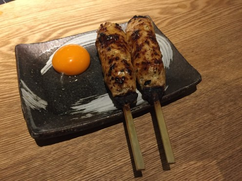 Tsukune (meatball) served with raw egg yolk. Delicious.