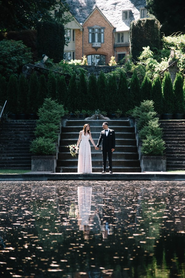 wedding in formal gardens with reflecting pool