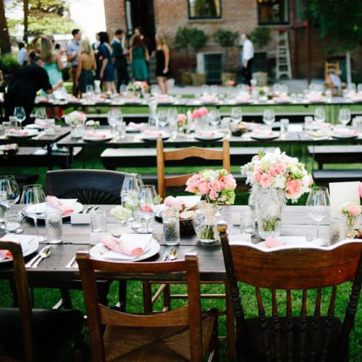 Wedding venues in The Dalles, Oregon. Photo of decorated tables in an open courtyard near a brick building.