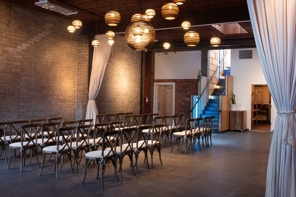 chairs in a large brick ballroom