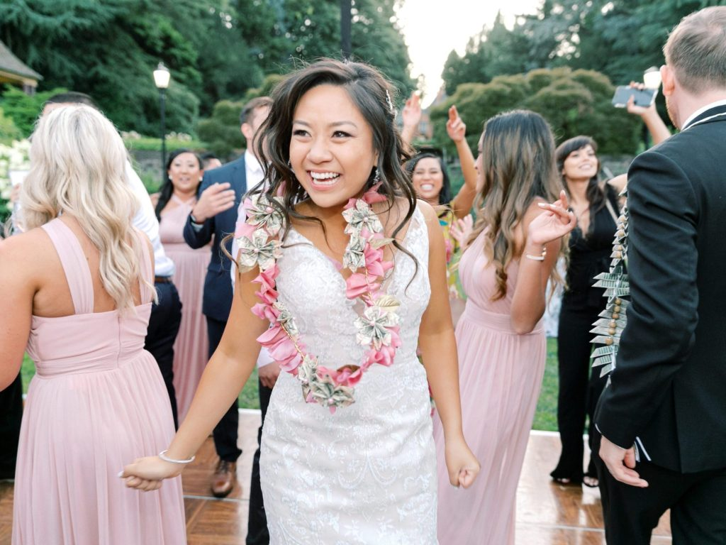 happy dancing bride wearing a lei of flowers