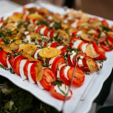 platter of fresh tomatoes, goat cheeses, herbs, and crackers