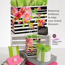 several packages and bags used in retail, with pink, green, and striped motifs