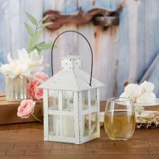 a small white lantern for wedding decor
