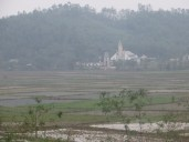 A Church across rice paddies