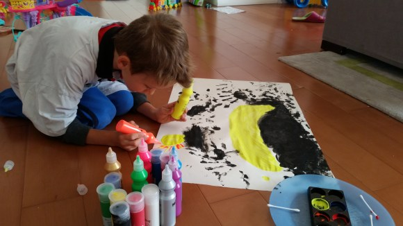 Enjoying his paints from Santa Clause