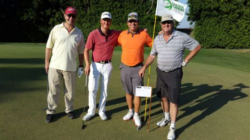 Brett Nelson, Sam Cutler (pro de Canada), Joaquín Siles, y Richard Dechert en el hoyo 4.