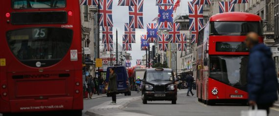 Union flags are attached between buildings along Oxford street in central london on June 27, 2016. Shares in banks, airlines and property companies plunged on the London stock exchange Monday as investors singled out the three sectors as being the most vulnerable to Britain's decision to leave the EU. / AFP PHOTO / ODD ANDERSEN